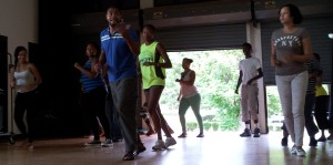 Rivert Diaz teaching UVI students how to dance salsa