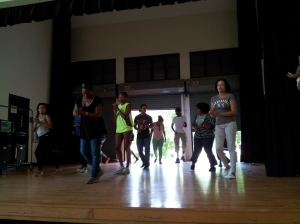 Humanities Professor, La Vaughn Belle teaching students how to dance Salsa