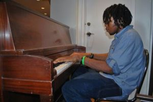 Jamal Francis playing the Piano