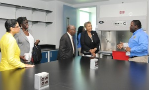 UVI's Student Government Association President Kevin Dixon, right, leads a tour of lab facilities in the new home of the College of Science and Mathematics during its unveiling Saturday, Oct. 26. Shown, from left, are UVI Trustees Carol Fulp, Jacqueline Sprauve, Edward Thomas and Jennifer Nugent-Hill.