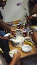 Digging in! : Residents partake in filling their bowls with varying flavors of Icecream and Syrup.