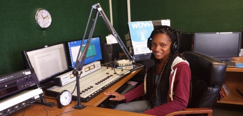 Marisha Jno-Lewis, news director of WUVI uses the DRS 2006 software to air her show at WUVI AM 1090.   Photo by Elisa Thomas