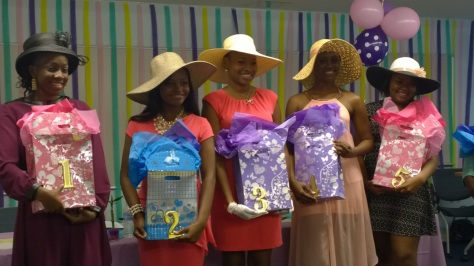 Miss UVI Contestants pose with gift bags received from the Queen's Committee at the contract signing. (From Left to Right: Kimberly Donovan, Elisa Thomas, Shanice Wilson, Sherisia Gumbs, and Nichole Ettienne) Photo Credit: Felicia Emmanuel