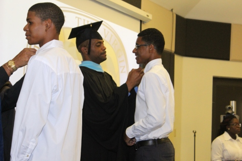 Dead of Student Affairs, Shemar Moore, Pinning Nursing student, Michael Cenac Jr. at Fall 2014 Convocation