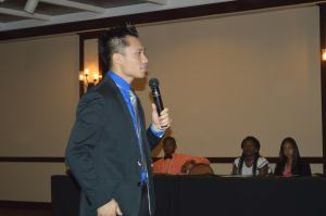 Hoan Do, Student Success Life Coach, addresses students at UVI Student Leadership Conference