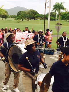UVI students and marching band walk in honor of Breast Cancer Awareness