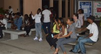 Students and visitors looks on at performances during UVI Mix event
