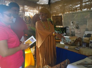 VICCC and CSAP director Dr. Chenzira Davis Kahina shares information with exhibit visitors on February 14 at the Agrucultural and Food Fair. Photo Credit: Felicia Emmanuel